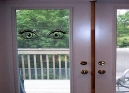 Eyes watching from the door